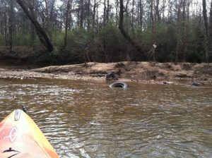 discarded tires in Pacolet River
