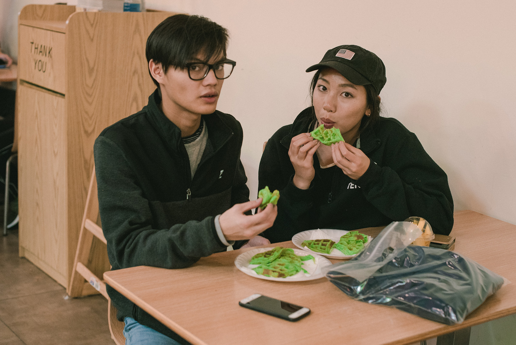 Photo of people eating pandan waffles