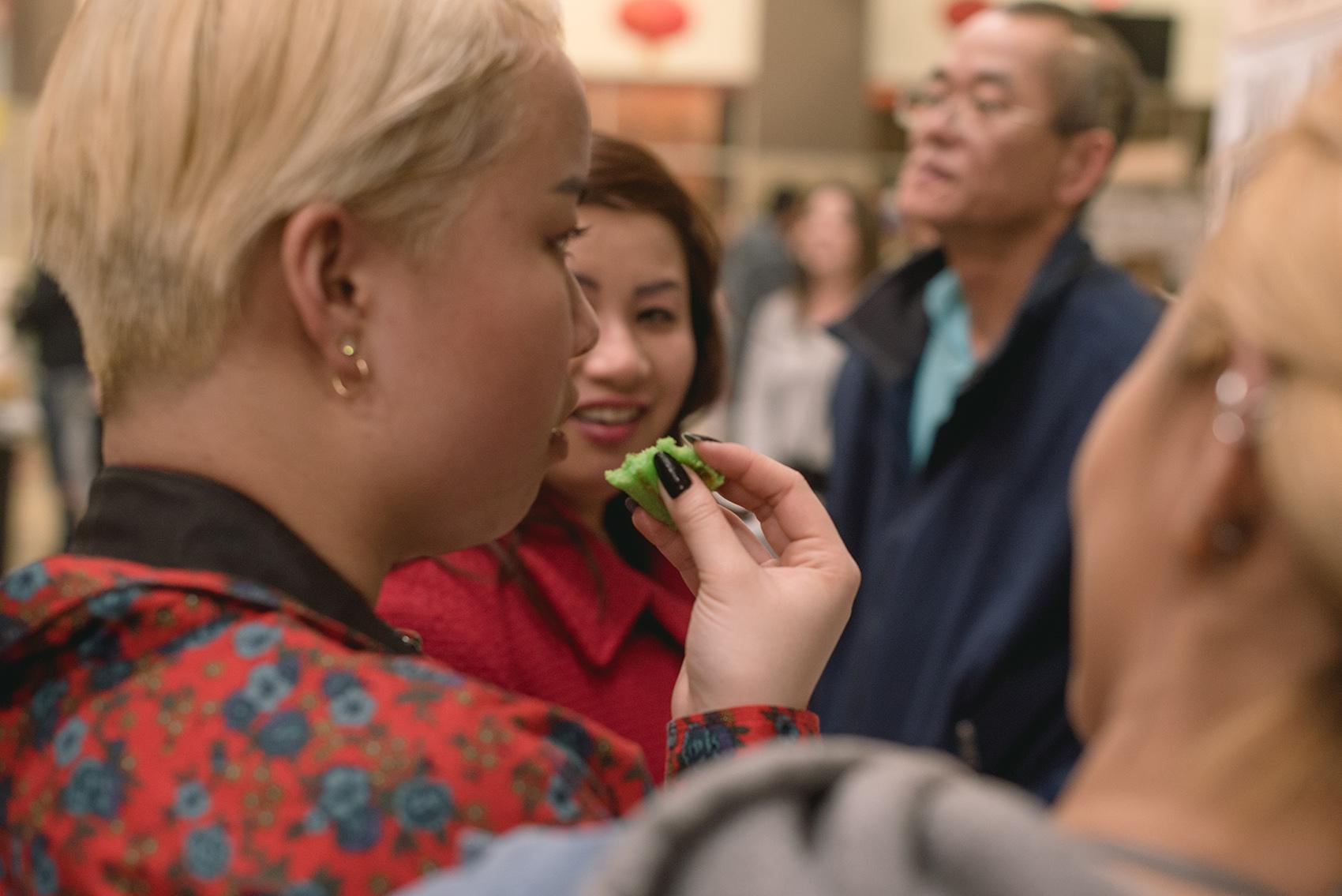 Photo of woman eating pandan waffle