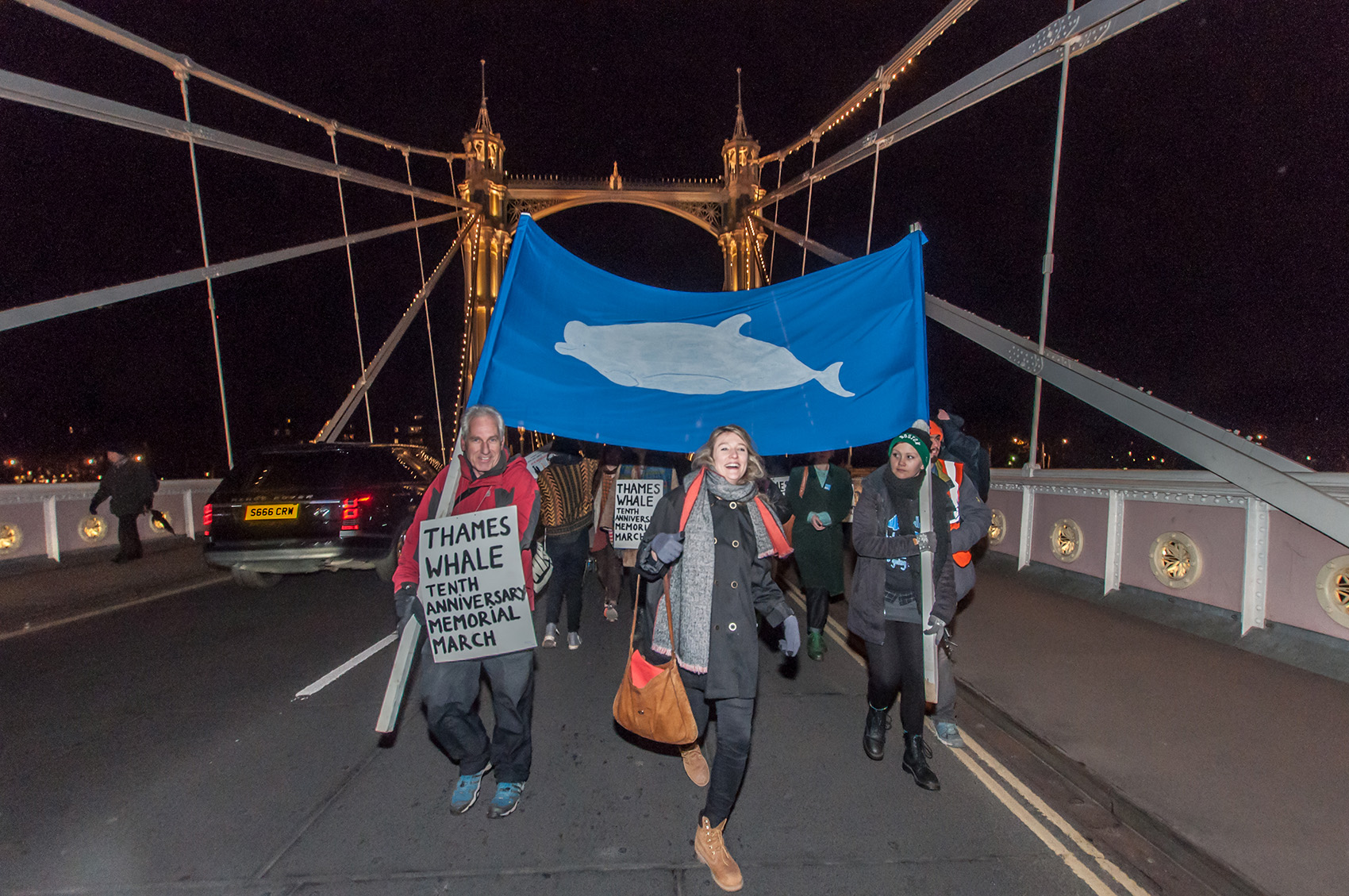 People marching with whale banner at the Ten Year Thames Whale Memorial March