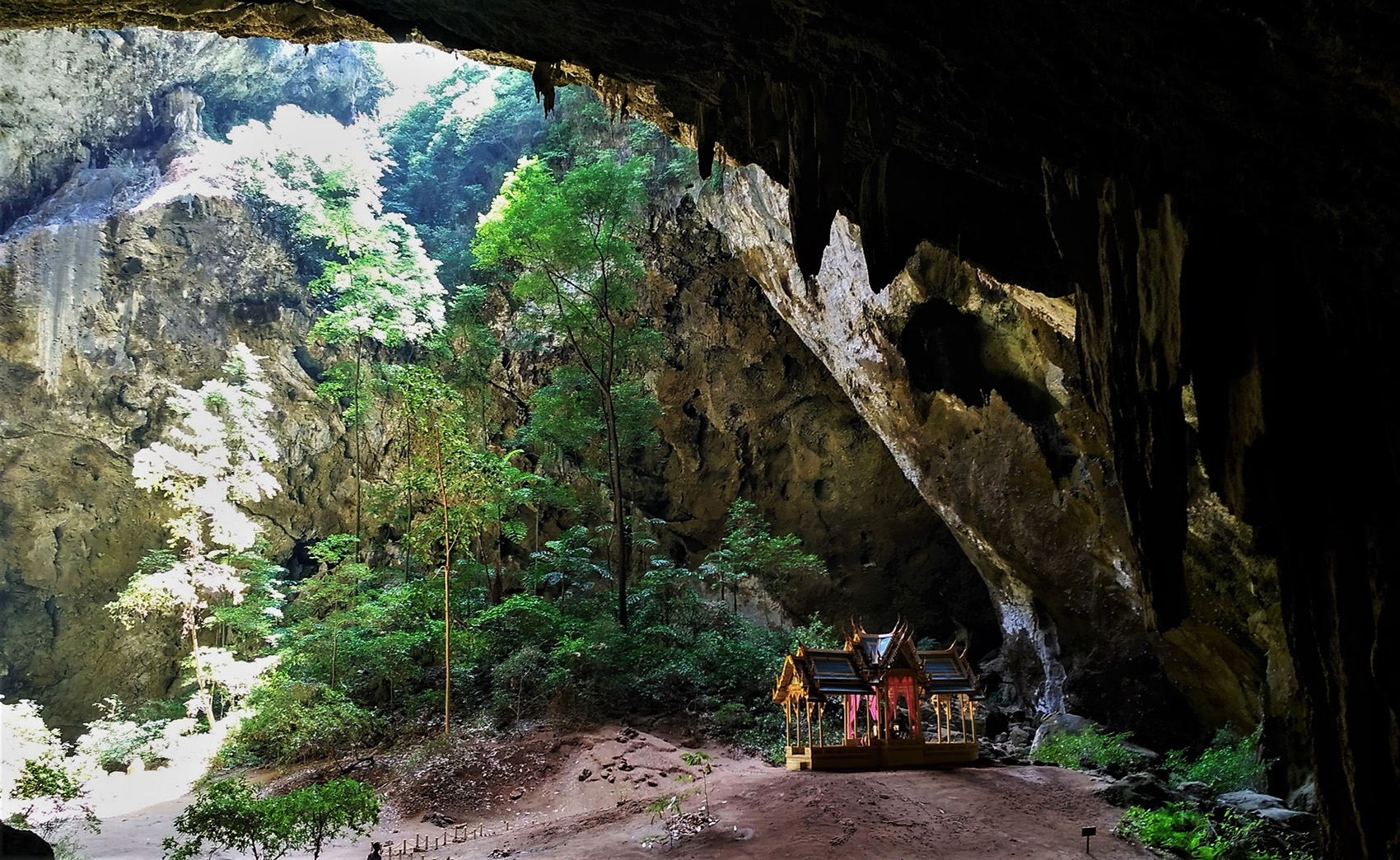 photo of an ornate house inside a cave