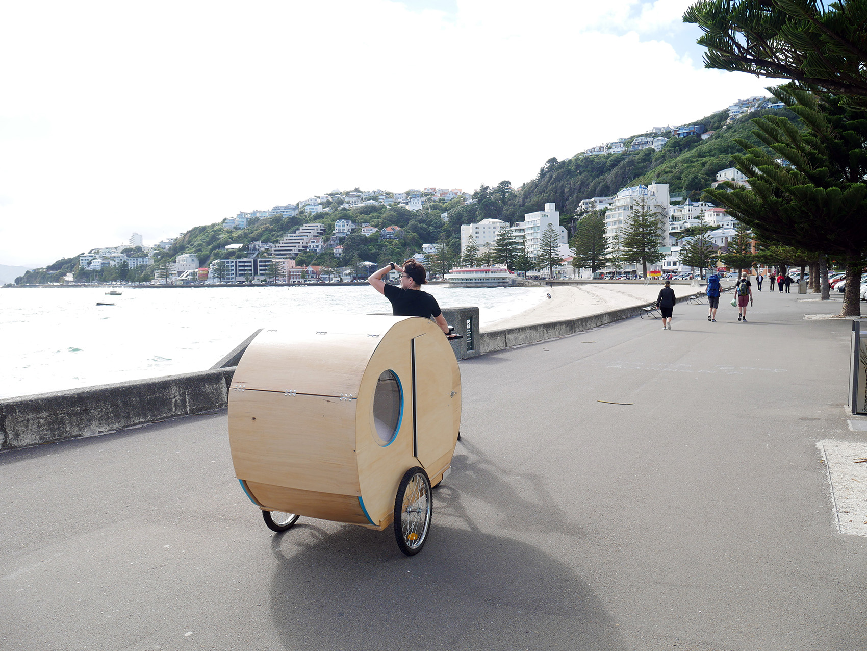 Caravan being towed by bicycle along Wellington Waterfront