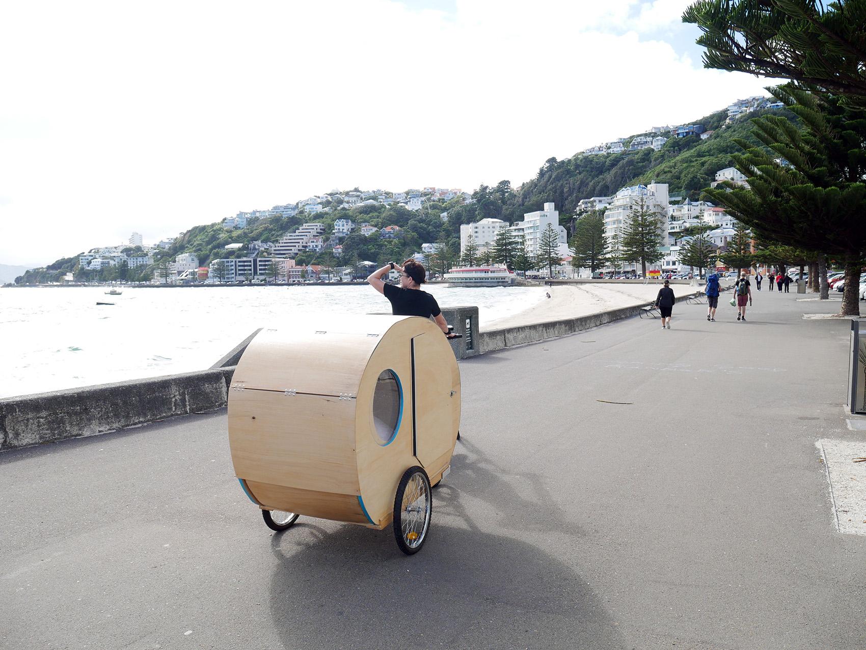 Caravan being towed by bicycle along Wellington Waterfront