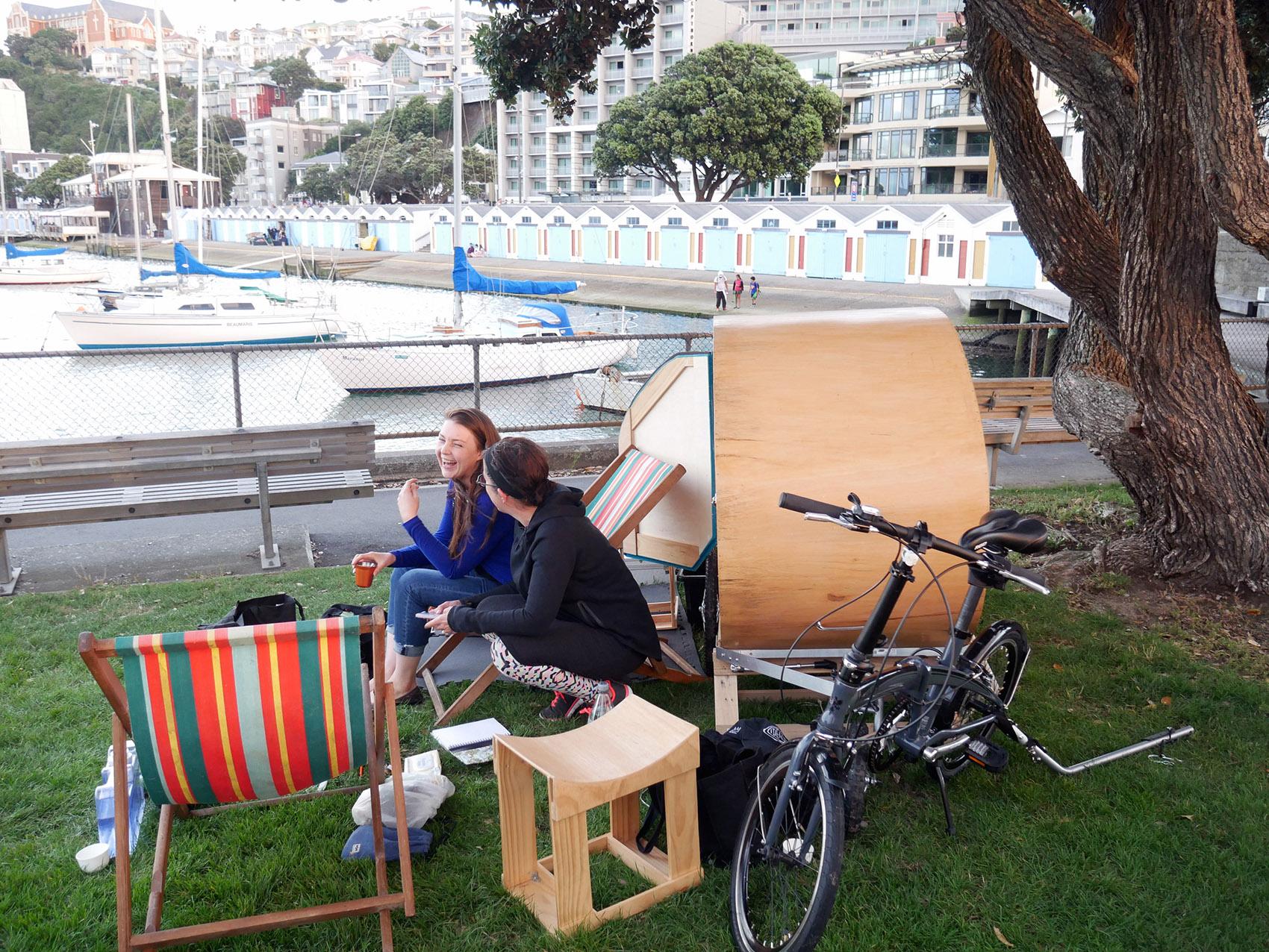 Caravan on grass by marina in Wellington