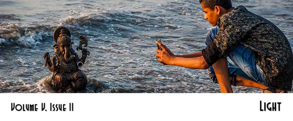 Section 1: Light - photo of a boy taking a picture of a sea deity