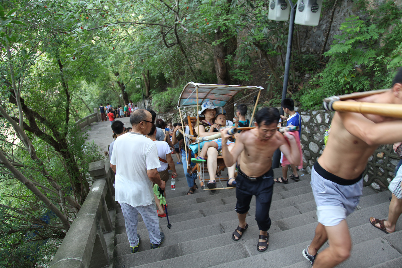 people descending and ascending concrete stairs at Three Gorges