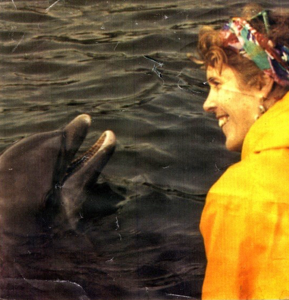Brenda Peterson with a bottlenose dolphin