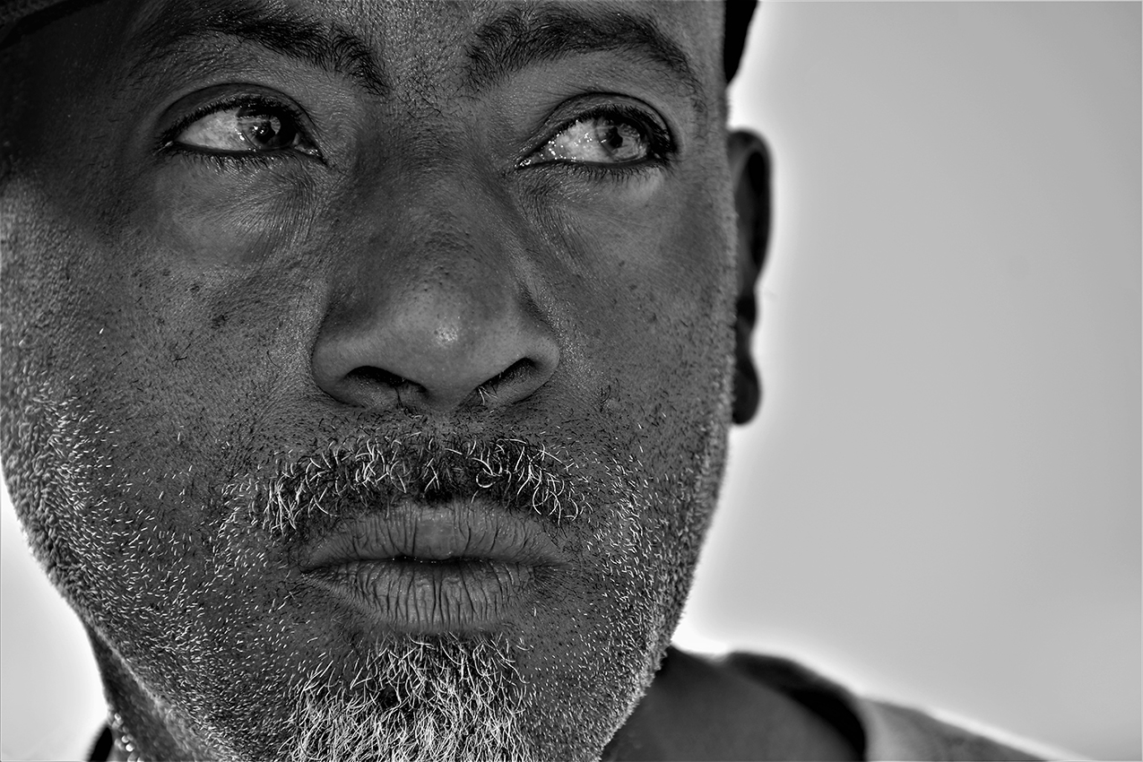 black and white asymmetrical portrait of a Haitian man