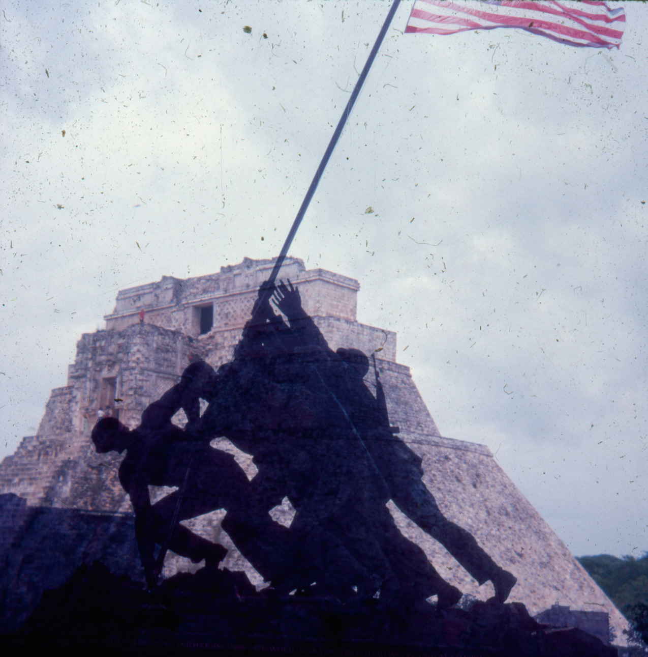 double-exposure photo featuring silhouetted Iwo Jima Memorial and ancient pyramids