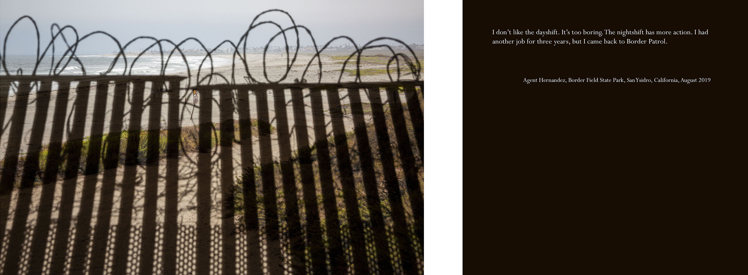 beach scene with shadows of a fence with razor wire