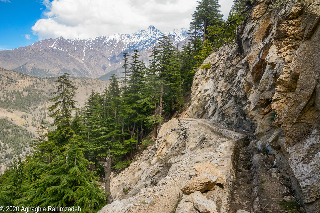 An irrigation channel in the side of a mountain in the Himalayas is designed to bring water down from far-away glaciers